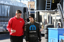 Bryan Clauson and team member in discusion