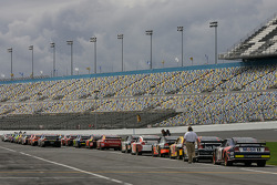 Cars wait on pit road