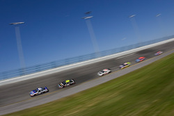 Greg Biffle leads a pack into turn 4