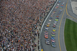 Jimmie Johnson and Michael Waltrip lead the field to the green flag