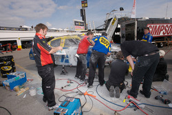 Best Buy Dodge crew members repair the car of Elliott Sadler