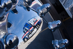 Reflection of the Mobil1 hauler off the near by wheel hub