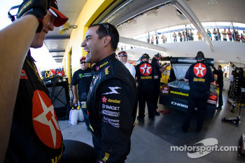Juan Pablo Montoya enjoys a laugh with his crew