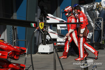 Kimi Raikkonen, Scuderia Ferrari stopped at entrance of pitlane