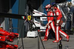 Kimi Raikkonen, Scuderia Ferrari stopped at entrance of pitlane