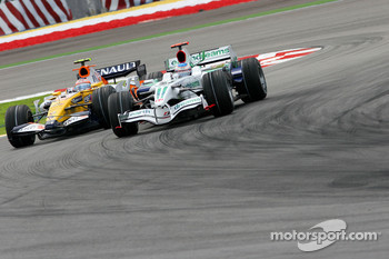 Jenson Button, Honda Racing F1 Team, RA108 and Nelson A. Piquet, Renault F1 Team, R28