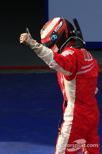 Race winner Kimi Raikkonen celebrates