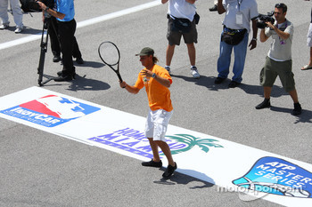 Tennis pro David Nabaldian in the match with Helio Castroneves on the Homestead front straight
