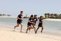 Renault F1 drivers training in Bahrain: Romain Grosjean, Renault R28, Fernando Alonso, Renault R28, Sakon Yamamoto, Renault R28 and Nelson A. Piquet, Renault R28 run on the beach