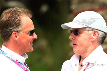 Johnny Herbert talks with David Robertson, Manager of Kimi Raikkonen