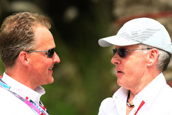 Johnny Herbert talks with David Robertson, Manager of Kimi Raikkonen