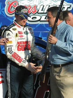 Dale Earnhardt Jr. is presented the $65,000 Bretta Shotgun