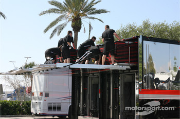 IndyCar crew members unload gear