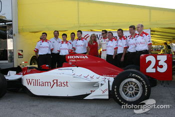 Townsend Bell poses with his crew