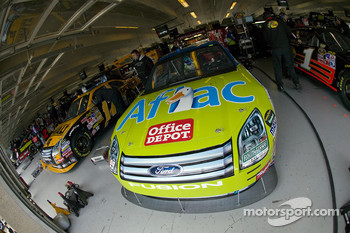 The cars of Matt Kenseth and Carl Edwards sit quietly in their garage stalls