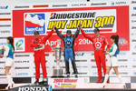 Podium: race winner Danica Patrick with Helio Castroneves and Scott Dixon