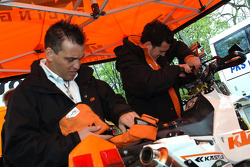KTM Repsol team members prepare for scrutineering