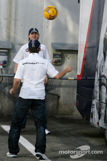 Robert Kubica,  BMW Sauber F1 Team, Christian Klien, Test Driver, BMW Sauber F1 Team, play football in the paddock