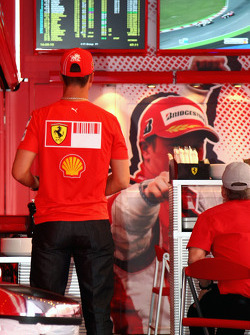 Michael Schumacher, Test Driver, Scuderia Ferrari, watches the GP2 Race