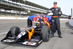 An IndyCar Series fan poses with the two-seater