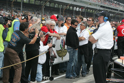 Photographers try to capture Michael and Mario Andretti