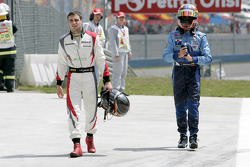 Jerome D'Ambrosio and Pastor Maldonado walk back to the pits