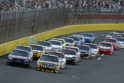 Elliott Sadler leads the field to the green flag to start the Sprint open