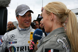Cora Schumacher, wife of Ralf Schumacher, interviewing her husband on the grid for DTM TV
