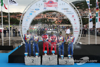 Podium: winners Sébastien Loeb and Daniel Elena, second place Mikko Hirvonen and Jarmo Lehtinen, third place Jari-Matti Latvala and Miikka Anttila