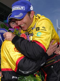 Romain Dumas and Timo Bernhard celebrate