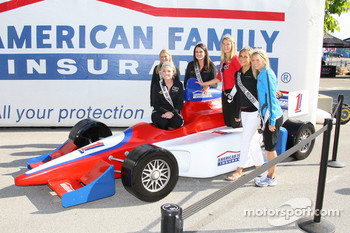 Indy 500 princesses pose with an Indycar