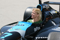 A fan sits in an Indycar