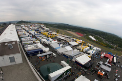 Overall view of the paddock before the race
