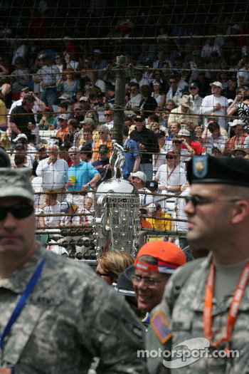 The Borg Warner Trophy sits among the crowd