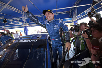 Second place Petter Solberg celebrates