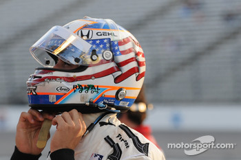 Graham Rahal tightening his helmet straps