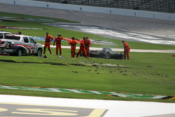 Dan Wheldon's wrecked car sits in the infield grass