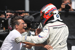 Race winner Robert Kubica celebrates with Dr. Mario Theissen