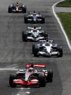 Heikki Kovalainen, McLaren Mercedes leads Nick Heidfeld, BMW Sauber F1 Team