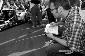 A man draws the cars