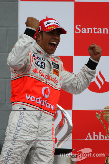 Podium: race winner Lewis Hamilton celebrates