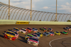 Joey Logano, Team Penske Ford and Ryan Blaney, Woods Brothers Racing Ford lead the field