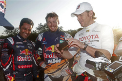 Car category second place Nasser Al-Attiyah, bike category winner Toby Price, car category third place Giniel de Villiers