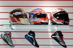 F1 Driver helmets and race shoes on display