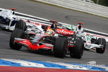 Lewis Hamilton, McLaren Mercedes, MP4-23 leads Rubens Barrichello, Honda Racing F1 Team, RA108