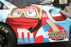 The rear of Kyle Busch's car sports a suba M&M
