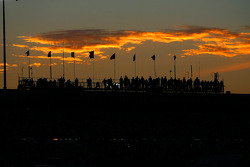 The skies fill with color as the sun sets over the Kroger 200