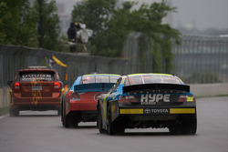 Marcos Ambrose leads Jacques Villeneuve under yellow