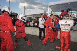 Stevenson Motorsports crew members celebrate GT class win