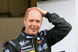 Race winner Eric Van de Poele celebrates